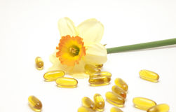 Narcissus and yellow pills Royalty Free Stock Image