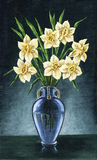 Narcissuses in a blue vase Royalty Free Stock Images