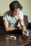 Narcotic addict make injection himself. Narcotic addict make injection of crack cocaine to himself. Drug use, crime, addiction, dependence and people concept Royalty Free Stock Images