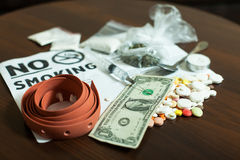 Narcotic dependence concept. Narcotics on wooden table. Drugs dependence concept Stock Photos