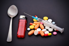 Narcotic pills. And syringe on black background Royalty Free Stock Photos
