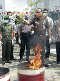 Narcotics. Security officers destroy evidence of narcotics in the city of Solo, Central Java, Indonesia stock photos