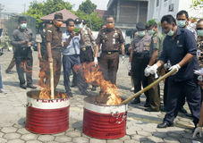 Narcotics. Security officers destroy evidence of narcotics in the city of Solo, Central Java, Indonesia royalty free stock photo