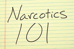 Narcotics 101 On A Yellow Legal Pad. The words `Narcotics 101` on a yellow legal pad stock photo