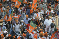 Narendra Modi rally at BHU. VARANASI - MAY 8: BJP party workers riding bikes and coming out of BHU just before the arrival of Indian Prime Minister Narendra royalty free stock photo