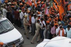 Narendra Modi in Varanasi. VARANASI - MAY 8: Security personal pushing the waiting crowd and making way for the convoy of Prime Minister Narendra Modi on May 8 Stock Photography