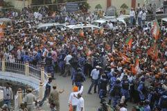 Narendra Modi in Varanasi. VARANASI - MAY 8: Security personal pushing the waiting crowd and making way for the convoy of Prime Minister Narendra Modi on May 8 Royalty Free Stock Image