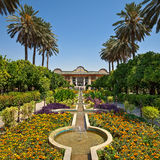 Narenjestane Qavam Garden in Shiraz with Persian Landscaping and Small Canals Leading to Pavilion. Beautiful Persian garden of Narenjestan Ghavam or Qavam with Stock Photography