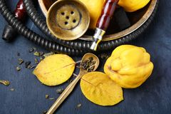 Nargile with quince. Smoking smoking hookah in Arabic style with the tobacco aroma of ripe quince stock photo