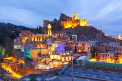 Narikala and Abanotubani at night, Tbilisi, Georgia. Amazing View of Narikala ancient fortress with St Nicholas Church, Jumah Mosque, Sulphur Baths and famous Stock Image