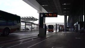 Bus stops at Narita Airport Terminal 1 in the morning. Narita,Japan-December 25, 2017: Bus arrives at Narita Airport Terminal1 bus stop in the morning stock footage