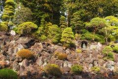 Statues and donations wall, Naritasan Shinshoji Temple, Narita, Royalty Free Stock Photos