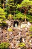 Statues and donations wall, Naritasan Shinshoji Temple, Narita, Royalty Free Stock Photo