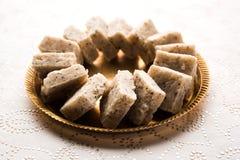 Nariyal Barfi / Coconut Burfi or Khobra Vadi, served in a bowl or plate. Fresh Nariyal Barfi / Coconut Burfi or Khobra Vadi, served in a bowl or plate over Royalty Free Stock Images