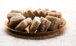 Nariyal Barfi / Coconut Burfi or Khobra Vadi, served in a bowl or plate. Fresh Nariyal Barfi / Coconut Burfi or Khobra Vadi, served in a bowl or plate over Stock Image