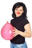 Nariz atractiva del payaso de la pizca de la señora y un globo Imagenes de archivo