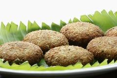 Narkel Posto Bora - A Bengali dish Royalty Free Stock Images