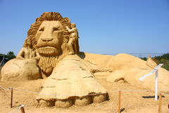 Narnia. Sand sculpture of Narnia movie on clear blue sky background Stock Photos
