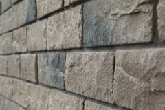 Narożnikowa struktura dom Tekstura - sztuczny dekoracyjnego kamienia façade siwieje kolor kamiennej ściany tła szorstką teksturę Zdjęcia Stock