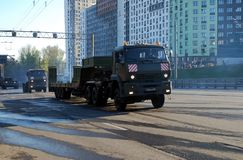 On Narodnogo Opolcheniya Street the military all-wheel drive KamAZ-65225 truck tractor with the trailer a trawl goes. Moscow. Russia. May 3, 2017. Preparation stock image