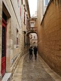 Narow street in Mdina, Malta. House with climbing plant inside Mdina, narrow street of stone in the old fortifications of Mdina, Medina, Malta, used in the tv stock photography