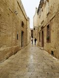 Narow street in Mdina, Malta. Narrow street of stone in the old fortifications of Mdina, Medina, Malta, used in the tv series Game of Thrones stock image