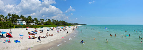 Narples, Florida beach scenery. Naples, USA - May 23, 2015: Tourists and ocals enjoy a sunny day on Naples Beach. Naples offers miles of beaches on the Gulf stock photos