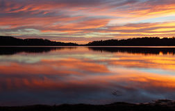 Narrabeen Lakes Reflections. Spectacular cloud reflections on Narrabeen Lakes at sunrise Royalty Free Stock Photo