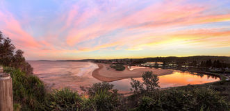Narrabeen panorama at sunset. Multiple image stitched panorama from Narrabeen Head, with views south along Narrabeen beach and Narrabeen lakes entrance Royalty Free Stock Photography
