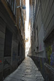 Narrow alley. Narrow dark alley with graffiti and many of light in the end Royalty Free Stock Photos