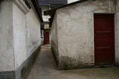 Narrow alley between aged dwelling buildings Royalty Free Stock Photo