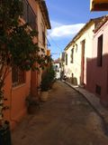 Narrow alley in Anafiotika area, Plaka district, Athens Greece. stock photo