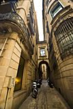 Narrow alley, Barcelona. Narrow alley with few motorcycles in Barcelona Stock Photo