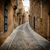 Narrow alley in Caceres (Spain). Detail of narrow cobblestone alley in Caceres (Spain royalty free stock photo