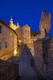 Narrow alley in the center of the city of Urbino. In the evening Royalty Free Stock Photo