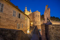 Narrow alley in the center of the city of Urbino. In the evening Stock Photo