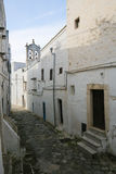 Narrow alley in the center of the medieval town Ostuni in Puglia Royalty Free Stock Images