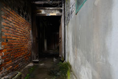 Narrow alley between Chinese ancient dwelling houses Stock Image