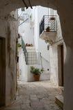 Narrow alley of Cisternino in Puglia Stock Image