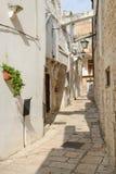 Narrow alley of Cisternino in Puglia Stock Photography