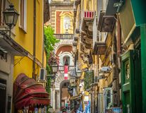 Narrow alley with Duomo steeple on the background in Sorrento. Narrow alley with Duomo steeple on the background in world famous Sorrento. Campania, Italy Stock Photo