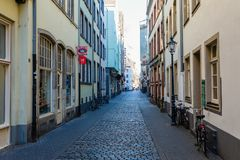 Narrow alley in the historic old town of Cologne, Germany royalty free stock images