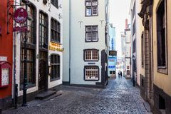 Narrow alley in the historic old town of Cologne, Germany royalty free stock image
