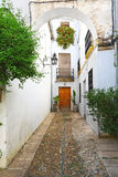 Narrow alley in Juderia district, Cordoba, Spain Stock Images