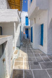 Narrow alley in Kimolos island, Cyclades, Greece Stock Images