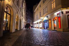Narrow alley with lanterns in Prague at night stock images