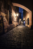 Narrow alley with lanterns in Prague at night royalty free stock photos