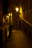 Narrow alley with lanterns in Prague at night Stock Photography