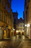 Narrow alley with lanterns in Prague at night Royalty Free Stock Image