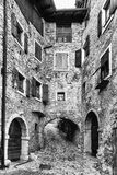 Narrow alley in a medieval village in Italy. Stock Photos